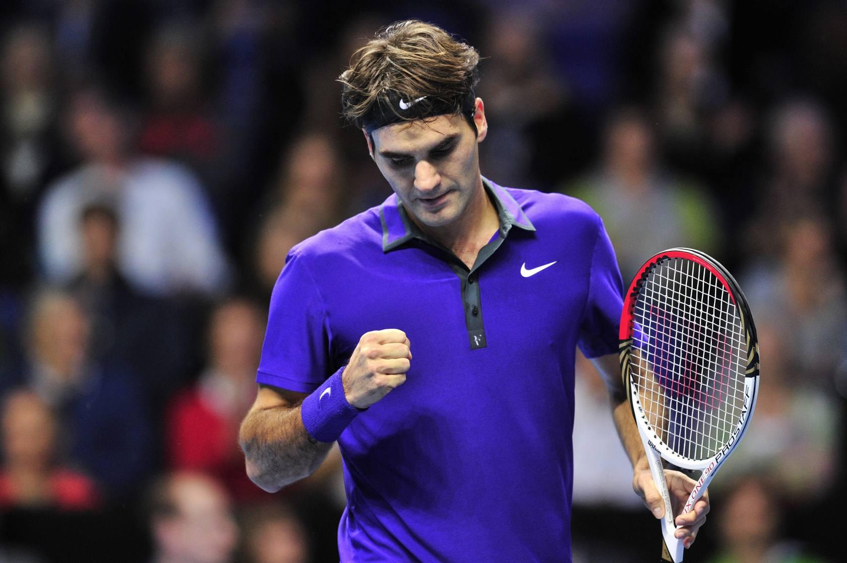 Federer derrota a David Ferrer en la Copa de Maestros